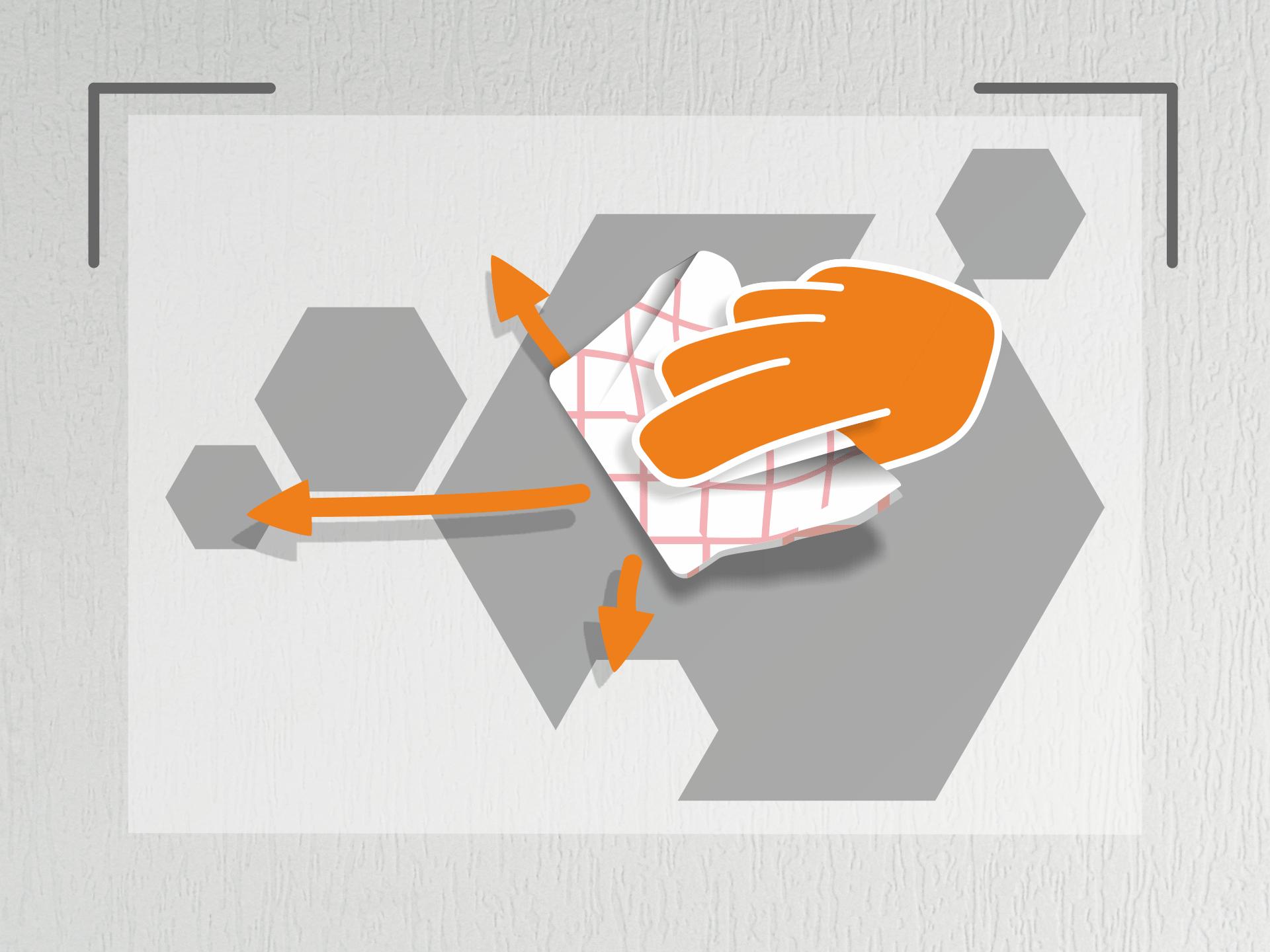 Jetzt den Aufkleber sehr straff halten und an den Markierungen auf der Wand anlegen. Nun das Geschirrtuch zu einem Ballen formen und die Tafelfolie (von der Mitte aus) mehrfach andrücken. Hinweis: Bei glatten Wänden kannst Du auch den Rakel zum andrücken nehmen.